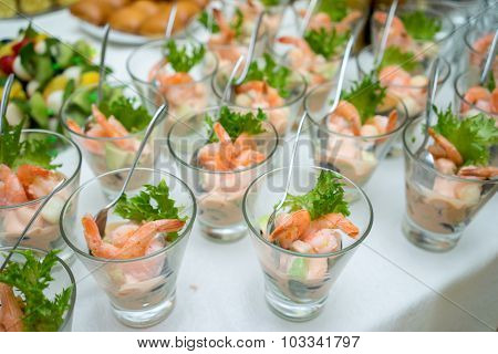 Shrimp Or Prawn Cocktail Snacks In Shot Glasses On Table. Healthy Shrimp Salad With Mixed Greens And