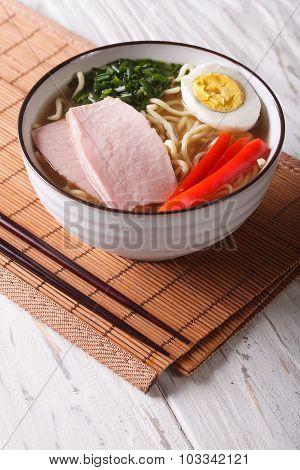 Ramen Noodles In Broth With Pork, Vegetables And Egg. Vertical