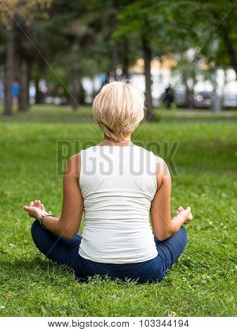 Girl Meditating In Park