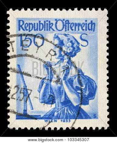AUSTRIA - CIRCA 1951: A stamp printed in Austria shows image woman in national Austrian costumes, Vienna, 1853, series, circa 1951