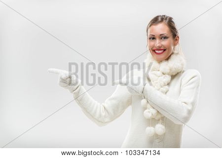 Girl In Winter Clothes Pointing Away