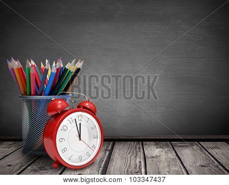 School supplies against black background