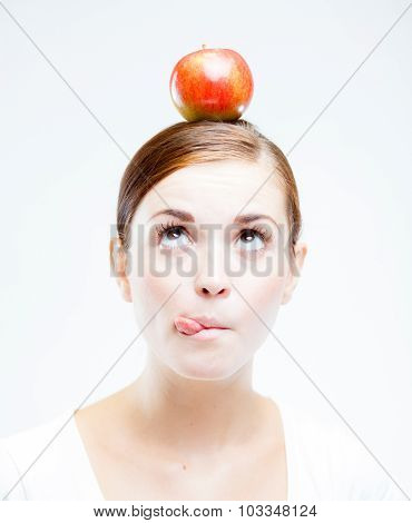 Woman With Red Apple On Her Head