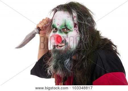 Evil Clown Holding A Knife, Isolated On White, Concept Horror And Murderer