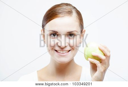 Smiling Woman Holding And Eating Green Apple