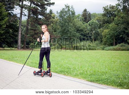 Woman Cross-country Skiing With Roller Ski