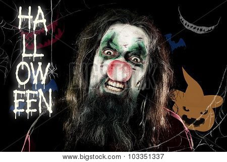 Scary Clown In Front Of A Black Background With A Pumpkin And Teeth, Text Halloween