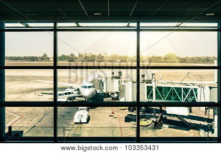 Modern Airport With Airplane At Terminal Gate Ready For Takeoff