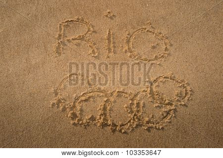 Olympic Rings Drawn In The Sand Under Rio 2016 Message On Ipanema Beach In Anticipation Of The City