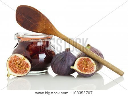 figs, jar of jam and cooking spoon isolated on white background
