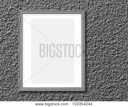 Metal window display frame isolated on cement wall background