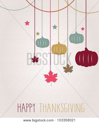 Thanksgiving greeting card. Hanging colorful pumpkins and maple leaves
