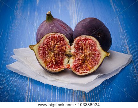 Three Ripe Figs On Blue Background