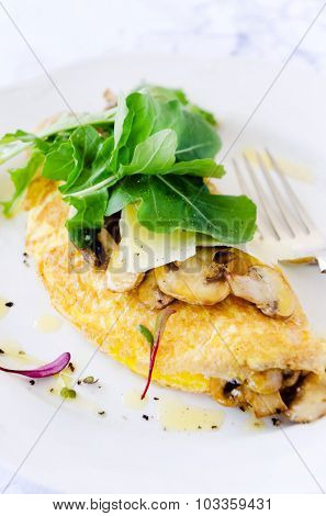 Scrambled omelette with sauteed mushrooms with fresh rocket, delicious wholesome breakfast