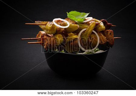 Three Skewers With Meat, Pepperoni On Black