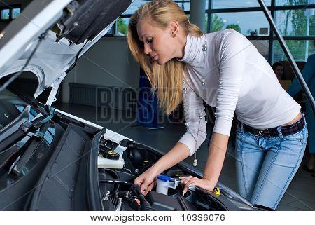 Young woman at broken car