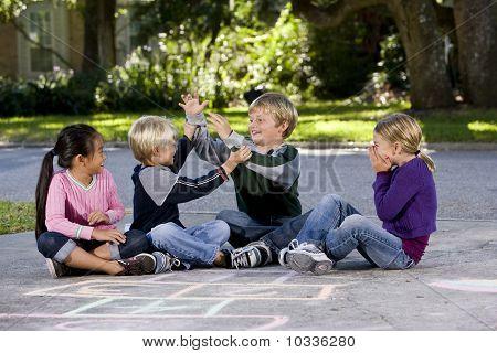 Girls Watching Boys Playing