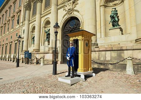 Guard stands on duty at the Royal palace in Stockholm, Sweden