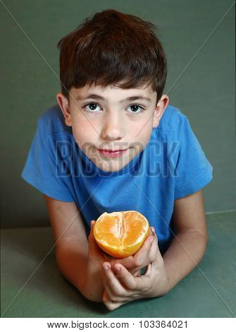 Handsome Boy Eat Orange Close Up Portrait