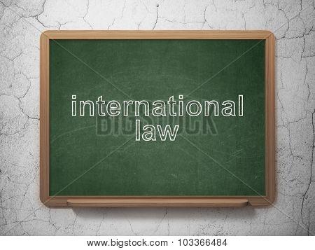 Political concept: International Law on chalkboard background