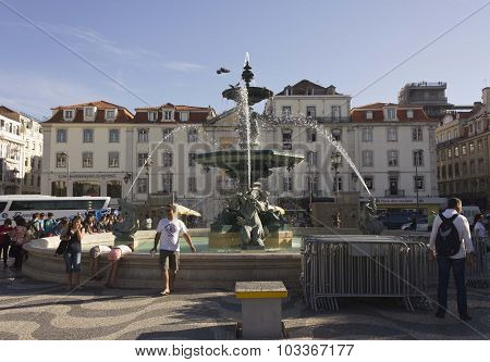 People Along Rossio Square Fountain