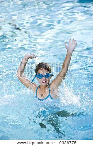 Happy Girl Splashing In Swimming Pool