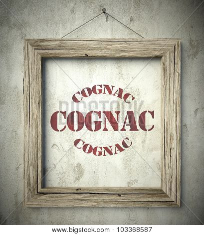 Cognac Emblem In Old Wooden Frame On Wall
