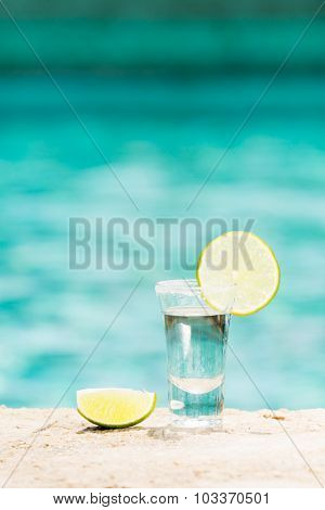 Tequila Shot With Lime On Blue Background