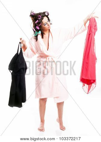 Woman In Bathrobe Choosing Clothes