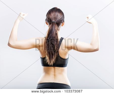 Fit Woman Flexing Her Biceps, Back View