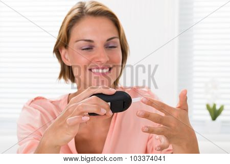Woman Checking Glucose Level