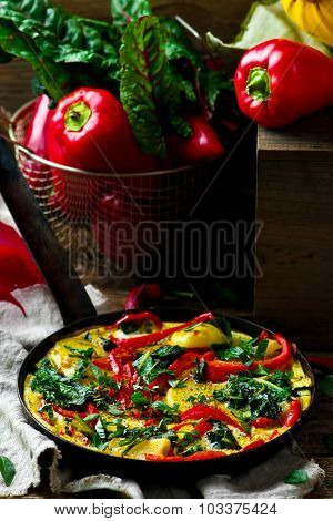 Fritatta With Potato, Pepper, And Swiss Chard.