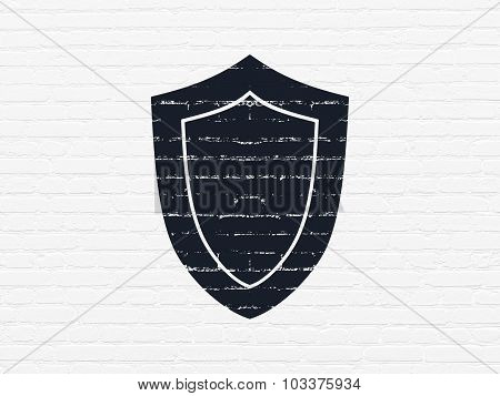 Protection concept: Shield on wall background
