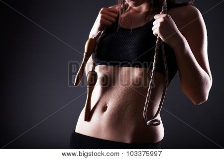Fitness Woman After Exercise With Jumping Rope
