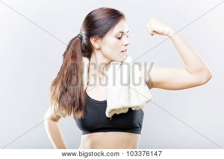 Sporty Woman Looking At Her Biceps After Exercise