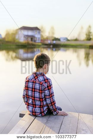 boy looking at the water pond