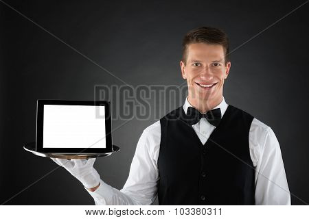 Butler Holding Tray With Digital Tablet