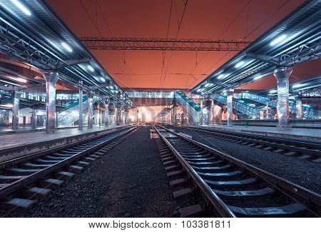 Railway station at night. Train platform in fog. Railroad in Donetsk