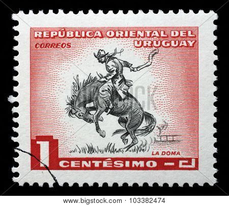 URUGUAY - CIRCA 1954: A stamp printed in Uruguay shows taming a horse, circa 1954.