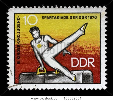 GDR - CIRCA 1970: a stamp printed in GDR shows Athlete on Pommel Horse, 3rd Childrens' and Youths' Spartakiad, circa 1970