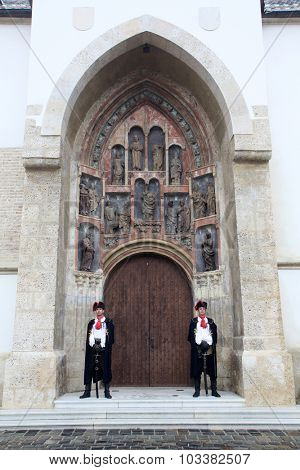 ZAGREB, CROATIA - SEPTEMBER 20: Guard of Honour of the Cravat Regiment on the south portal of the church of St. Mark in Zagreb, Croatia on September 20, 2014