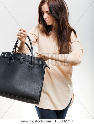 Elegant Young Woman Looking In Her Purse