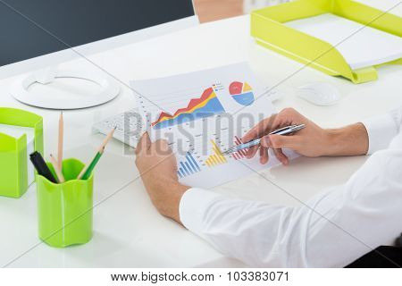 Businessperson Working On Graph