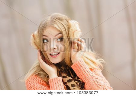 Smiling Fashion Woman In Sweater And Earmuffs.