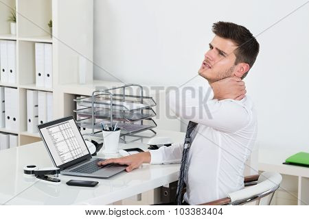 Young Businessman Having Neckache