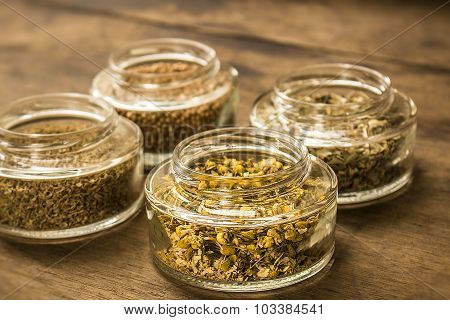 Spices and herbal tea ingredients on glass jars