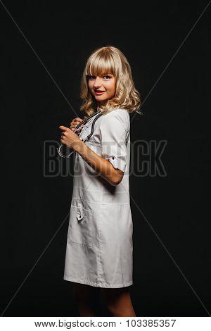 Nurse woman doctor in a white coat posing