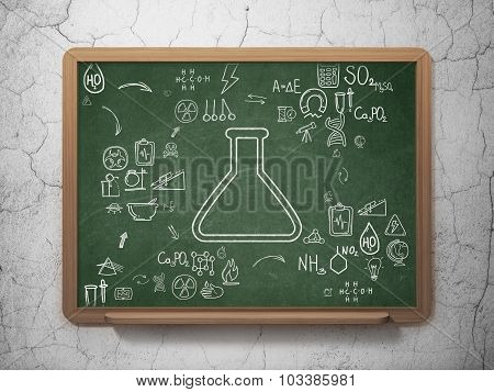 Science concept: Flask on School Board background