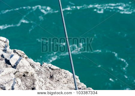 Tight Steel Cable Over Rock Edge And River