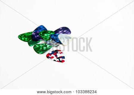 Many Guitar Picks Plectrum In Different Colors On White